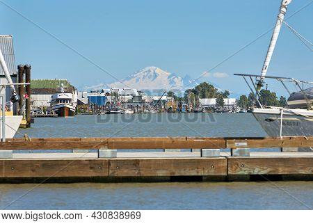 Richmond, British Columbia, Canada - July 13, 2018. Steveston Harbor Dock And Mount Baker. The Docks