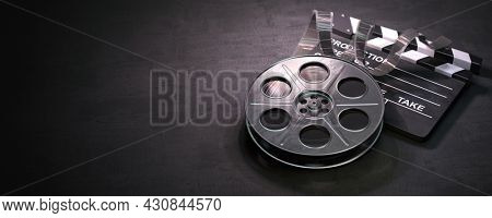 Film reel and clapper board on black background. Movie, video and cinema prodaction and edition concept. 3d illustration