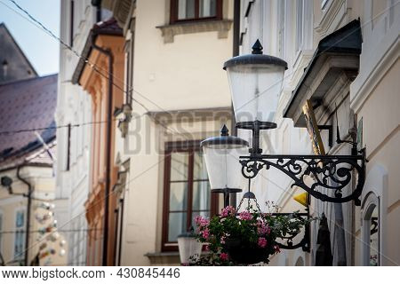 Selective Blur On A Vintage Old Public Lamp, Typical Lantern From The 19th Century, On A Street Of L