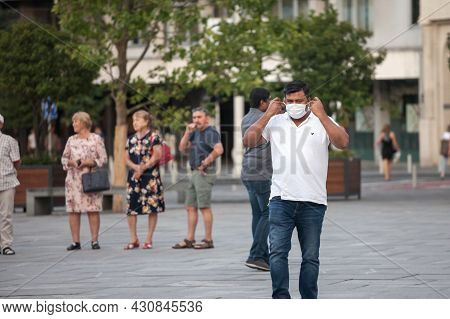 Belgrade, Serbia - July 22, 2021: Indian Tourist,  Middle Aged Man From India, Touching And Adjustin