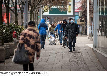 Belgrade, Serbia - March 6, 2021: Old Senior Man Wearing A Respiratory Face Mask Walking On Kneza Mi