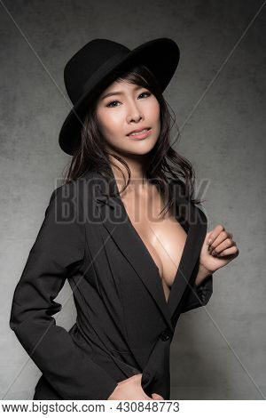 Sexy Woman In Studio Wearing Fashionable Suit.