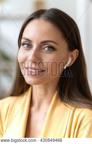 Businesswoman Use Wireless Headphones Gadget Working Remotely Or On Freelance. Portrait Of Successfu
