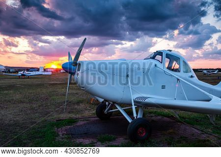Close-up An Airplane For Carrying Out Aeronautical Chemical Works In The Airfield Against The Backdr