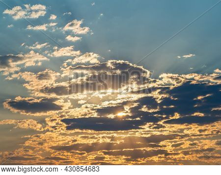 The Sun's Rays Pass Through The Clouds Beautiful Clouds At Sunset. Peace And Idyll In Heaven.