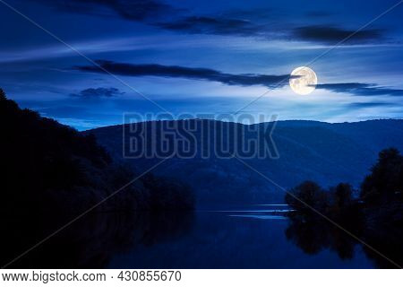 Beautiful Scenery With Lake At Night. Dark Clouds Reflecting On The Water Surface. Wonderful Autumna