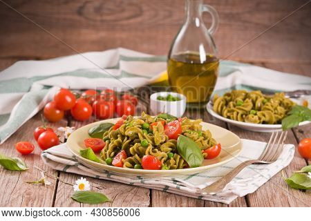 Fusilli Pasta With Cherry Tomatoes And Peas.