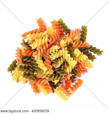 Heap Of Raw Tricolor Fusilli Gluten Free Pasta Isolated On White Background. Italian Colorful Macaro
