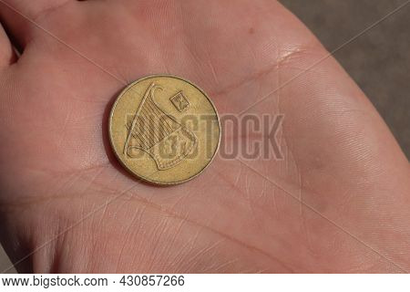 Modern Israeli Coin In The Hand. 0, 5 Sheqel. High Quality Photo