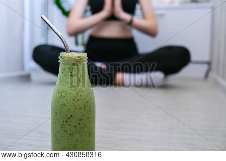 Seasonal Matcha Green Vegan Smoothie With Chia Seeds And Mint Smoothie Drink Detox. Woman Doing Yoga