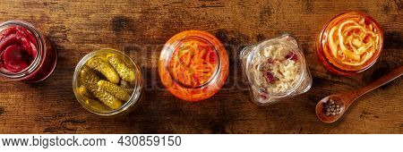 Fermented Food Panorama, Shot From The Top. Canned Vegetables. Pickles, Sauerkraut And Other Marinat