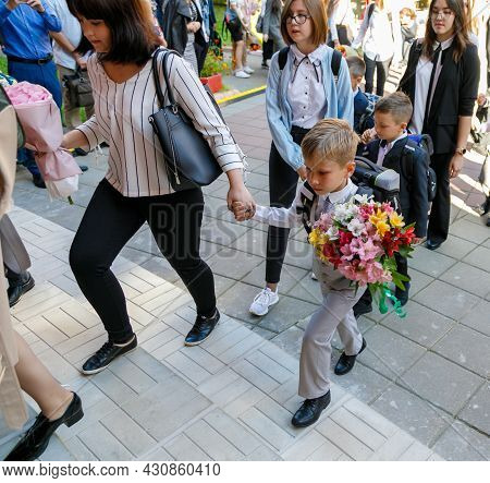 First Graders With Their Parents Go To School. First Of September. School. First Grade.