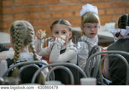 First Graders Eat In The School Cafeteria. Moscow, Russia, September 2, 2019