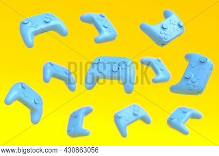Flying Blue Gamer Joysticks Or Gamepads On Yellow Background With Blur