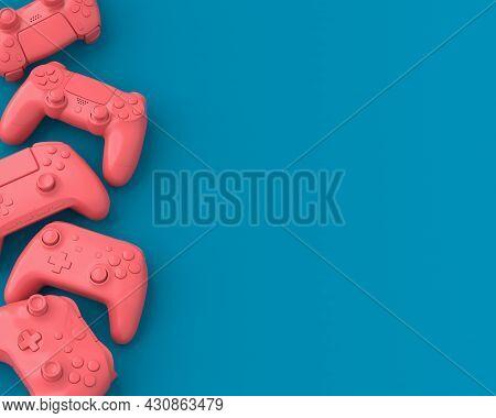 Set Of Lying Gamer Joysticks Or Gamepads On Blue And Pink Background