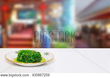 Table Top On Seafood Background. Fresh Chuka Or Seaweed Salad With Sesam On Plate On White Table In