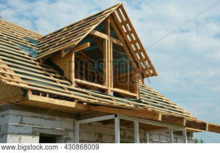 An Unfinished Attic Roofing Construction. Roof Framing Of An Attic With Vapor Barrier, Roof Beams, T