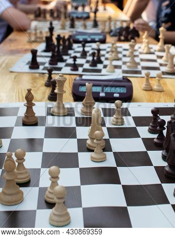 Close-up Of The Hands Of People Playing A Massive Chess Tournament. Entertaining The Crowd With Gamb