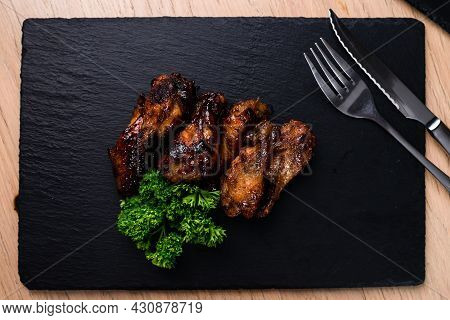 Fried Chicken Wings On The Cafe Table