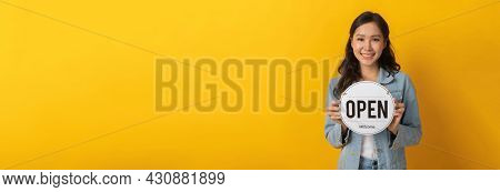 Wide Banner. Happy Pretty Woman In Casual Clothing Smiling And Hold Open Sign Board With Copy Space
