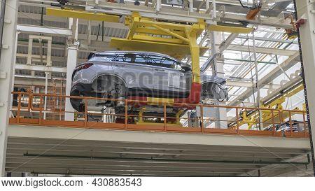 Car Production Line. Assembling Cars At Conveyor Assembly Line. Modern Assembly Of Cars At The Plant