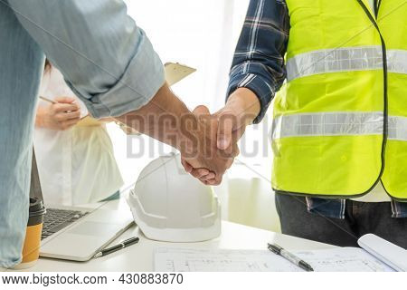 Contractor Handshake With Customer After Business Meeting Start Up Project Contract In Construction