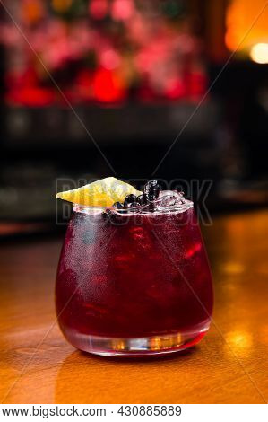 Fresh Red Water With Lemon And Raspberry. Exotic Summer Drink With Citrus Slices