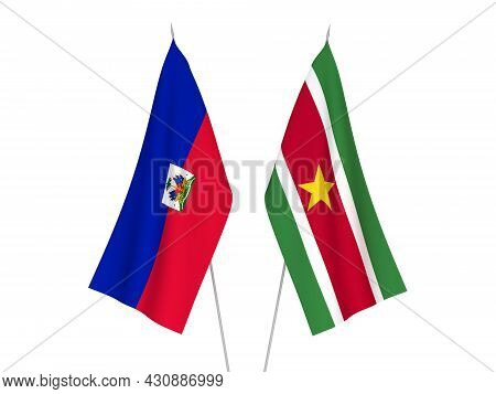 National Fabric Flags Of Republic Of Haiti And Republic Of Suriname Isolated On White Background. 3d