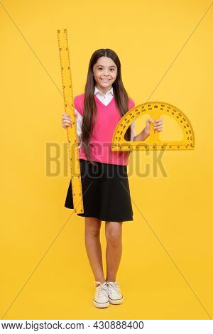 Cheerful Teen Girl Study Math With Protractor Ruler Measuring Size, Back To School