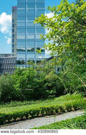 Zurich, Switzerland - July 13th 2019: View From Old Botanic Garden Towards A Glassen Skyscraper