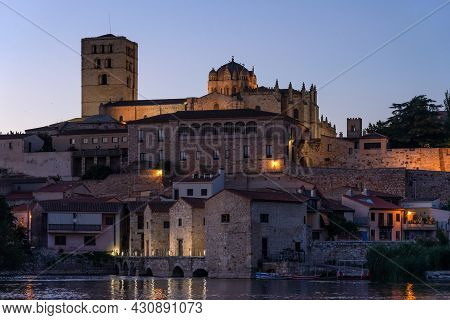 Zamora, Spain - August 14, 2020: Zamora Romanesque Cathedral And Bell Towers Since Duero Riverbank I