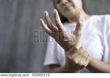 Close Up Young Woman Wrist Pain,  Health Care Concept, Guillain Barre Syndrome