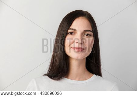 Woman Portrait Isolated Against White Background. Young Woman With Clean Face Skin. Self Care Concep