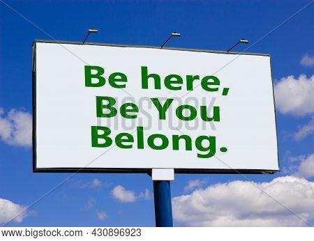 You Belong Here Symbol. Words 'be Here, Be You, Belong' On White Billboard. Beautiful Blue Sky. Busi