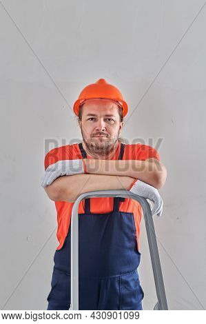 A Very Serious Repairman Leaned On A Stepladder