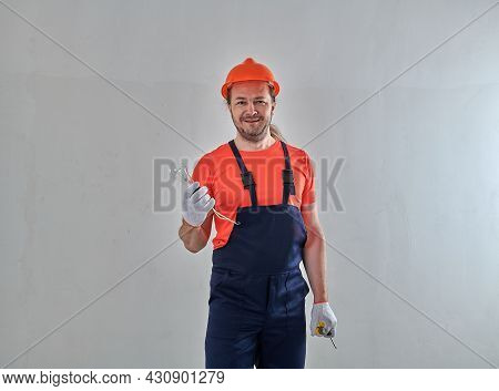A New Light Bulb In The Hands Of A Professional Electrician