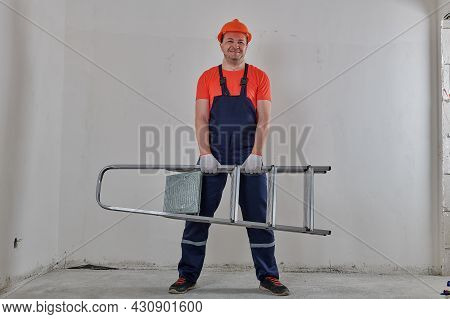 A Strong Man Holding A Ladder In Front Of Him