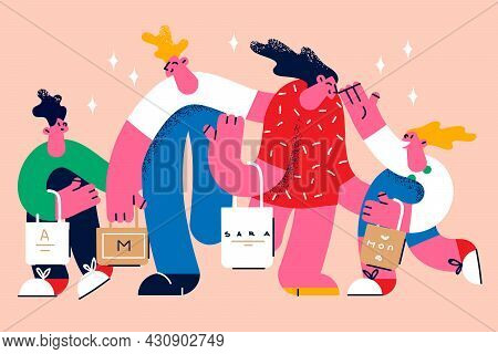 Shopping With Family Together Concept. Happy Family Father Mother And Children Carrying Bags With Pu
