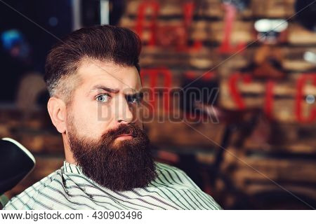 Bearded Man At Barber Shop. Men Hairstyle, Beard And Mustache. Fashion And Male Beauty. Brutal Serio