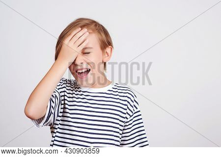 Boy Slapping Forehead With Palm And Closing Eyes. Unhappy Kid Forgetting Something. Face Emotion And
