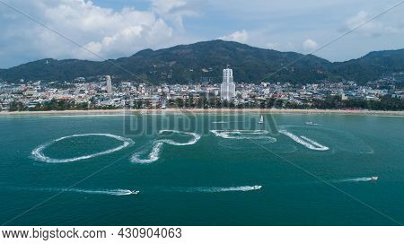 Aerial View Of Patong Bay Beautiful Popular Beach In Phuket With People Are Playing A Jet Ski In The
