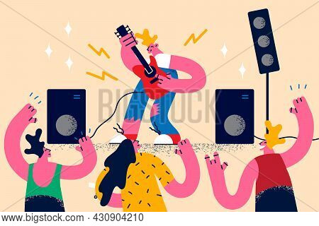 Rock Guitar Music And Concert Concept. Young Blond Man Star Guitar Player Or Singer Playing Music On