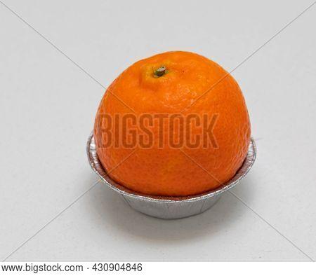 One Clementine Mandarin Tangerine Orange Fruit In Holder At Table