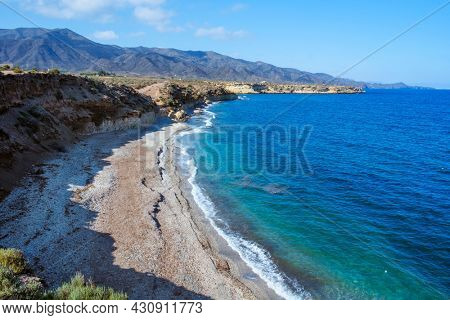 a view over Playa Larga beach, in Lorca, in the Costa Calida coast, Region of Murcia, Spain, with the Calnegre mountain range in the background