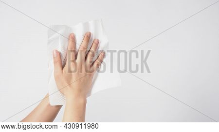 Hand Is Wiping Tissue Paper On White Background.
