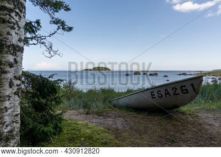 Kasmu, Estonia - 10 August, 2021: Small Wooden Boat On The Shores Of The Idyllic Laheema National Pa