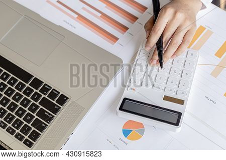 Businessman Working In A Private Office, She Is Reviewing The Company's Financial Documents Sent Fro