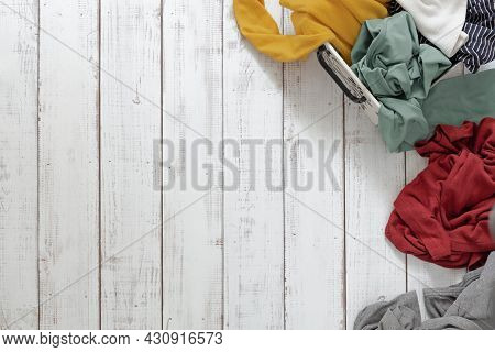 A Pile Of Clothes On A Wooden Floor, The Concept Of Washing And Cleaning, Chaos And Mess In Things,