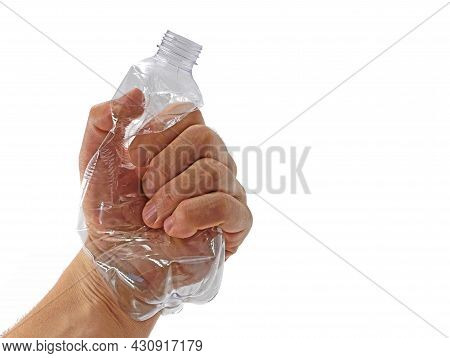 Male Hand Crushing Transparent Plastic Bottle With Copy Space, Fighting Against Plastic Pollution, R