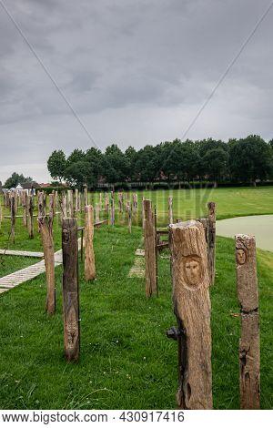 Diksmuide, Flanders, Belgium - August 3, 2021: Faces Of War Exhibition Brings 129 Wooden Sleepers To